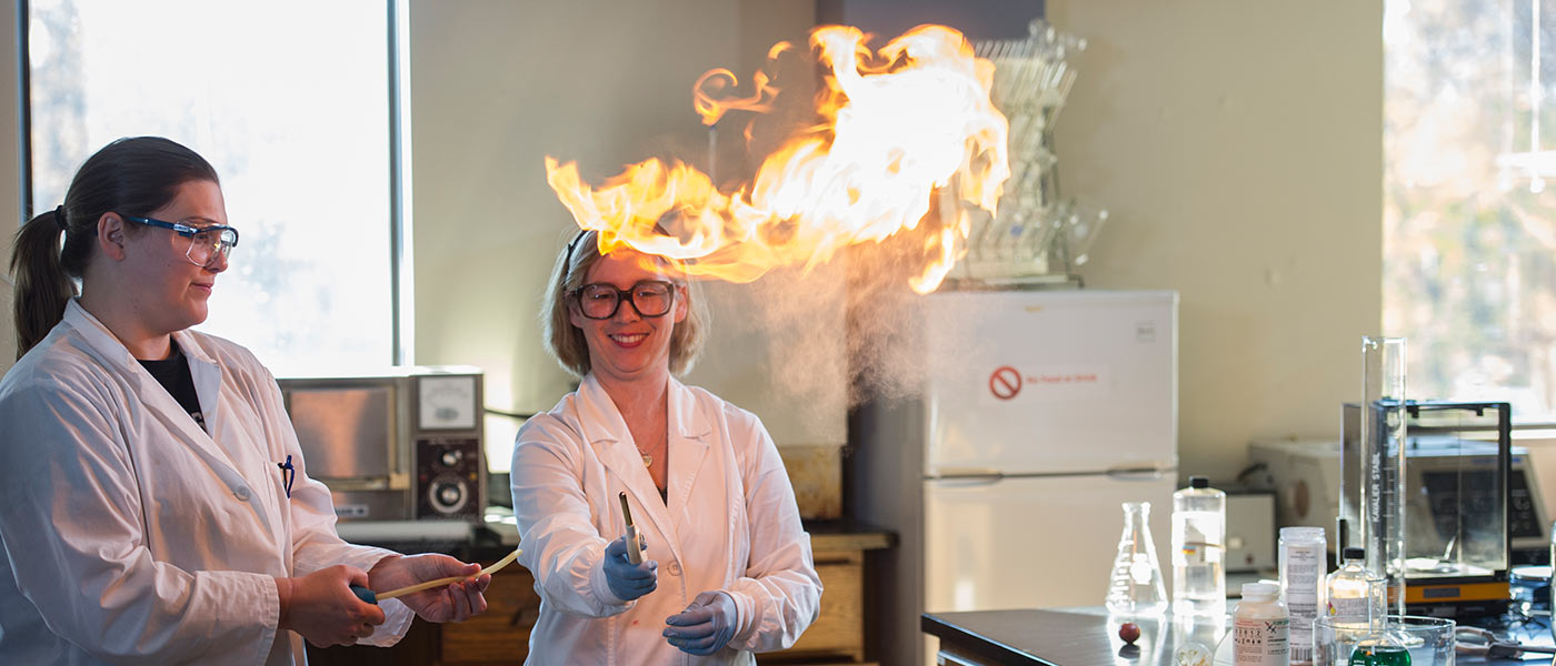 USF student and professor in the chemistry lab creating fire.