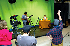 Film students working on a TV studio set