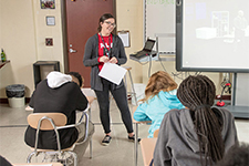 Female educator teaching in front of a class