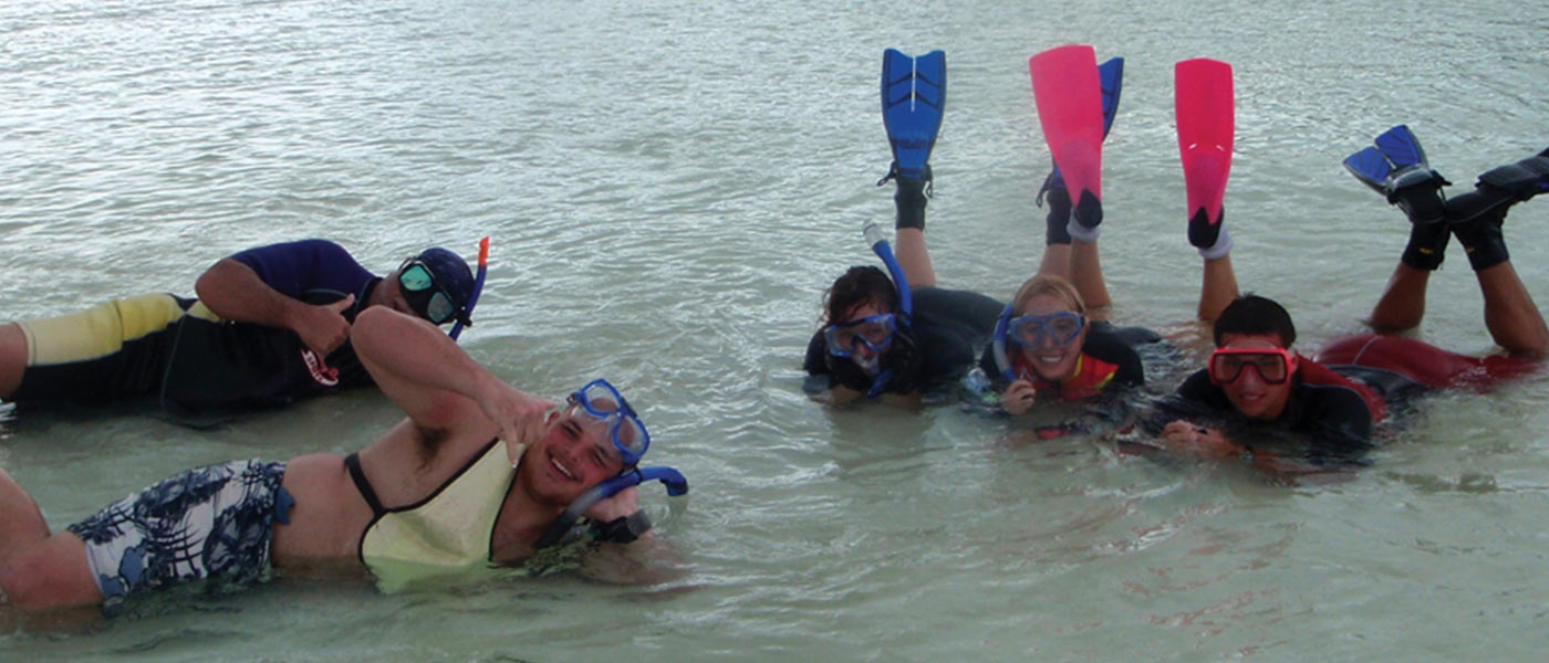 Group of environmental science student in the water with scuba gear on in the Bahamas.