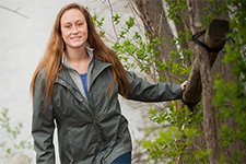 Environmental Science graduate Emily Richardson walking along the campus nature trail