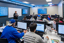 Students participating in a class in the Finance Lab at the USF Business Center