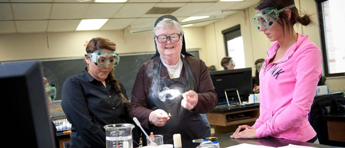 Sr. Carol Myers making a flame via science