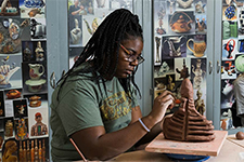 a studio art major working with some clay pottery